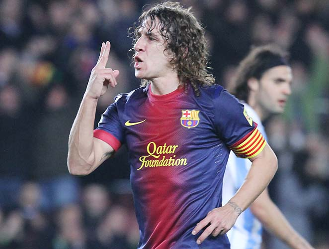 Carles Puyol and Barcelona are into the Champions League final 16 and lead La Liga.