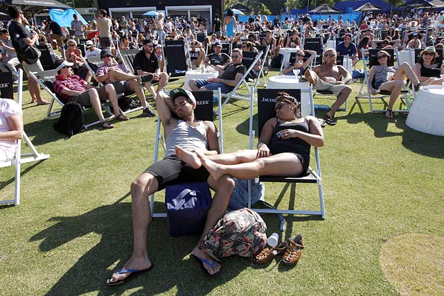While you shiver through winter, mate, fans at the Australian Open chill in the best way: They booze, sunbathe, nap, wave flags and watch a nice bit of tennis. L. Jon Wertheim takes you down under yo bask in some 100-degree heat, mingle among the locals, and relax in an all-too distant world. (Check out SI's web version of the magazine.)