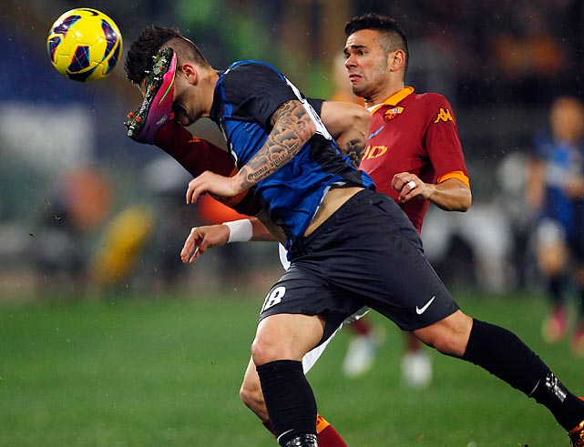 Inter Milan forward Marko Livaja catches a boot from AS Roma defender Leandro Castan during a Serie A soccer match in Rome's Olympic Stadium. The game ended in a 1-1 draw as Inter's Rodrigo Palacio equalized in the 45th minute following Francesco Totti's 22nd minute penalty kick.