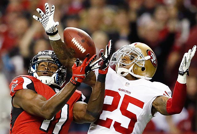 San Francisco 49ers cornerback Tarell Brown breaks up a pass to Atlanta Falcons wide receiver Julio Jones during the second half of the NFC Championship Game. It was a rare pass breakup on Jones, who torched the 49ers for 182 yards and two touchdowns. Despite the second-year receiver's big day, San Francisco defeated Atlanta 28-24 to earn its first trip to the Super Bowl in 18 years.