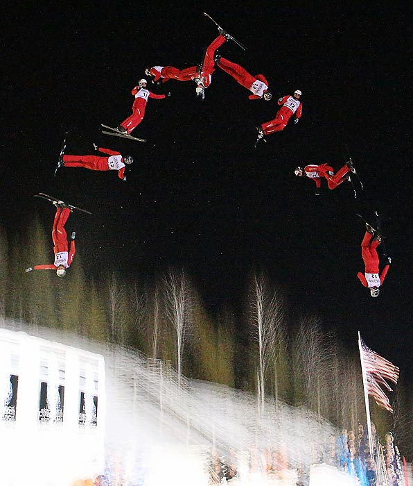Seen through multiple exposures, Swiss skier Thomas Lambert flips and spins in the qualification round of the USANA Freestyle World Cup aerial competition at the Lake Placid Olympic Jumping Complex on Jan. 19.
