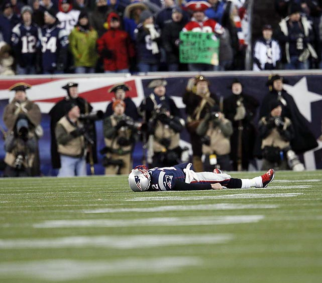 New England Patriots quarterback Tom Brady lies flat on the turf at Gillette Stadium during the AFC Championship Game. Brady had a rough game in the loss, tossing two interceptions that helped seal the Ravens' win.