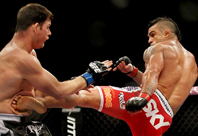 Vitor Belfort (red shorts) kicks Michael Bisping during a UFC fight in Sao Paulo, Brazil. Belfort won the fight when he dropped Bisping with a high kick in the second round.