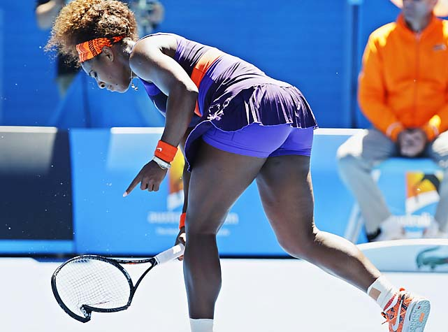 Williams breaks her racket in frustration during the match.