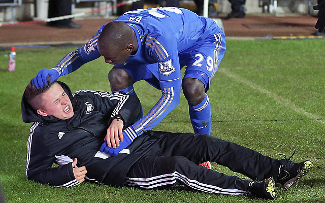 Demba Ba checks on a ball boy who had earlier clashed with Chelsea star Eden Hazard.