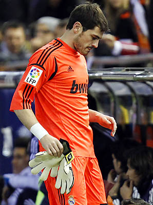 Real Madrid's goalkeeper Iker Casillas leaves the field injured during a Copa del Rey match against Valencia.