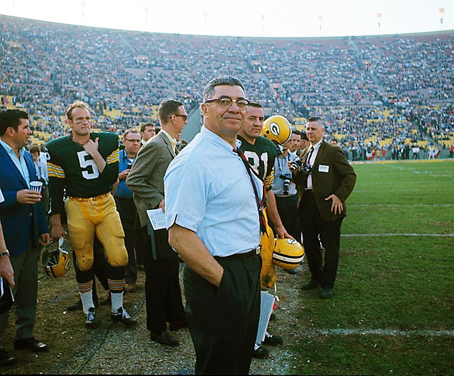 Vince Lombardi smiles on the sideline as he watches his Green Bay Packers defeat the Kansas City Chiefs 35-10. After a close first half, the Packers scored 21 consecutive points to run away with the game.