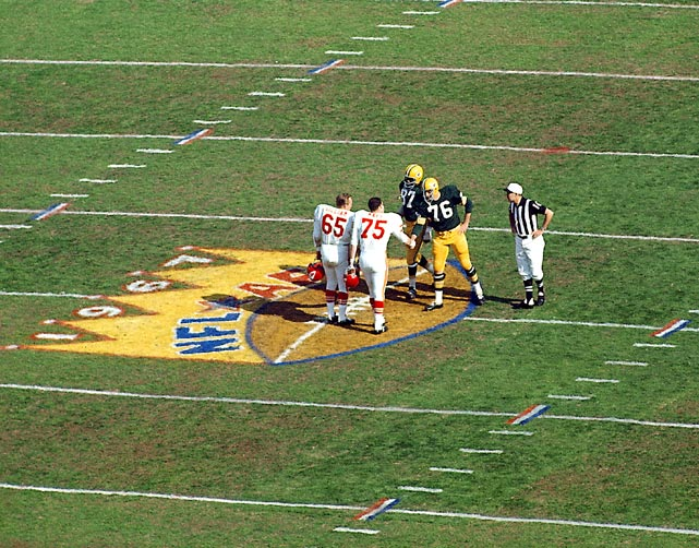 Jon Gilliam and Jerry Mays of the Kansas City Chiefs greet the Green Bay Packers' Willie Davis and Bob Skoronski at midfield before the start of the first Super Bowl. At the time the game was known as the First AFL-NFL World Championship Game or the Super game. It was the only Super Bowl to not sell out. Green Bay won 35-10.