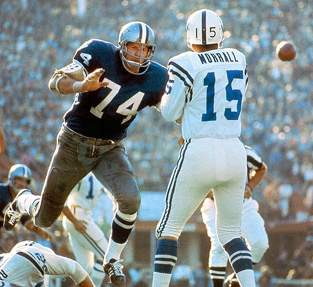 Baltimore Colts quarterback Earl Morrall gets a pass off as Dallas Cowboys defensive tackle Bob Lilly bears down on him. Morrall entered the game only after starting quarterback Johnny Unitas left with a rib injury. Despite completing less than 50 percent of his passes with no touchdowns, Morrall did just enough to guide the Colts to a 16-13 win over the Cowboys.