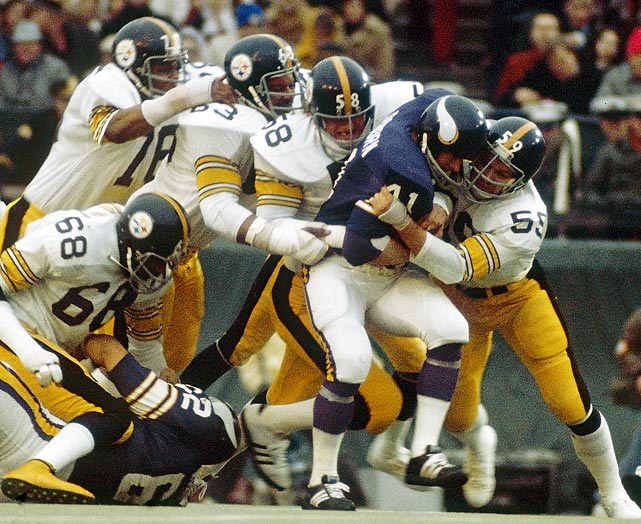 Jack Ham, Jack Lambert, Ernie Holmes and Dwight White of the Pittsburgh Steelers swarm to Minnesota Vikings fullback Dave Osborn. Pittsburgh's Steel Curtain defense contained the Vikings, limiting them to just 119 total offensive yards in pacing a 16-6 win.