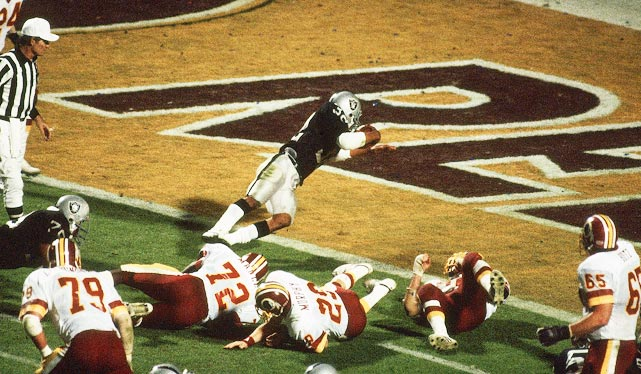 Marcus Allen dives into the end zone for his first of two touchdowns against the Washington Redskins. The Los Angeles Raiders running back was named Super Bowl MVP after rushing for a Super Bowl-record 191 yards in the Raiders' 38-9 victory.
