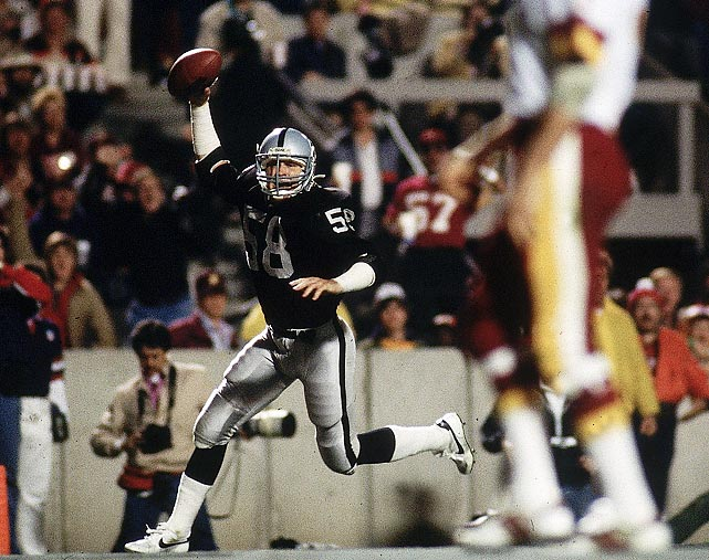 Jack Squirek raises the ball in triumph after intercepting Washington Redskins quarterback Joe Theismann for a touchdown en route to a 38-9 win for L.A. The Los Angeles Raiders linebacker jumped Theismann's screen pass after the Redskins had run the same play for a 67-yard gain in the team's regular season meeting.