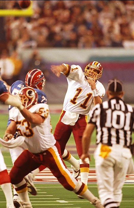 Washington Redskins quarterback Mark Rypien tosses a pass against the Buffalo Bills. Rypien earned Super Bowl MVP honors by throwing for 292 yards and two touchdowns on 18-of-33 passing in the Redskins' 37-24 win.
