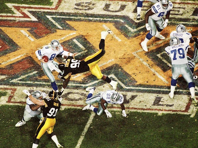 Pittsburgh Steelers linebacker Levon Kirkland dives at the feet of Dallas Cowboys quarterback Troy Aikman. Aikman threw for 209 yards and a touchdown on 15-of-23 passing in the 27-17 victory to become just the third quarterback to win three Super Bowls.