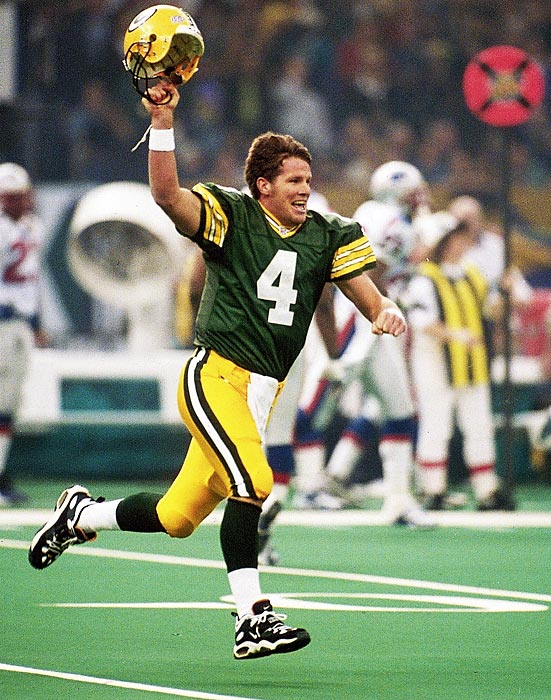 Brett Favre raises his helmet in celebration after throwing a 54-yard touchdown pass to wide receiver Andre Rison in the first quarter. The Green Bay Packers quarterback completed 14 of 27 passes for 246 yards and two touchdowns while rushing for another touchdown in the 35-21 triumph.