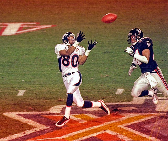 Wide receiver Rod Smith awaits a bomb from John Elway after gaining separation from Atlanta Falcons free safety Eugene Robinson. Smith took the ball for an 80-yard touchdown to expand the Denver Broncos' lead to 14 points in the second quarter. They went on to win 34-19.