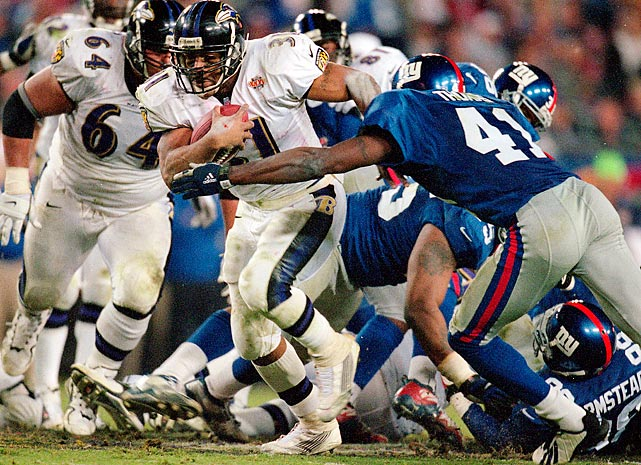 New York Giants cornerback Dave Thomas attempts to wrap up Jamal Lewis in the fourth quarter. The Baltimore Ravens' rookie running back gained 102 yards on the ground, becoming just the second rookie to rush for 100 yards in a Super Bowl. He also scored a fourth-quarter touchdown as the Ravens rolled to a 34-7 win.