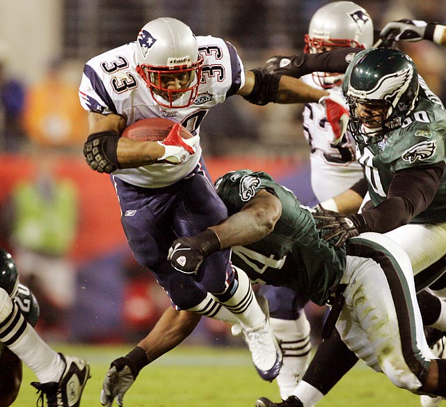 New England Patriots running back Kevin Faulk attempts to leap through a tackle in the second quarter. Faulk gained 65 total yards and had two catches and a rush that set up of the Patriots winning score in their 24-21 victory over the Philadelphia Eagles.