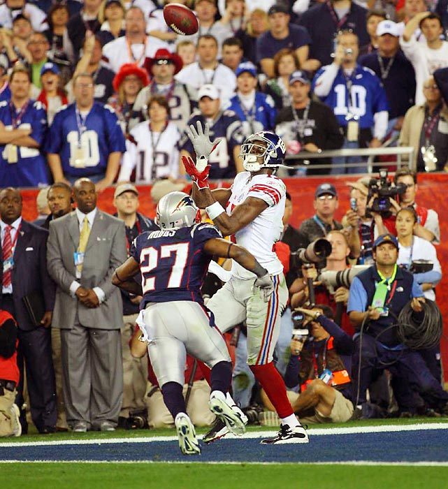 Plaxico Burress eyes the football as it floats in to him for the game-winning touchdown. The New York Giants wide receiver caught the pass from quarterback Eli Manning with 35 seconds left to upset the New England Patriots 17-14, ruining the Patriots' bid for a perfect season.