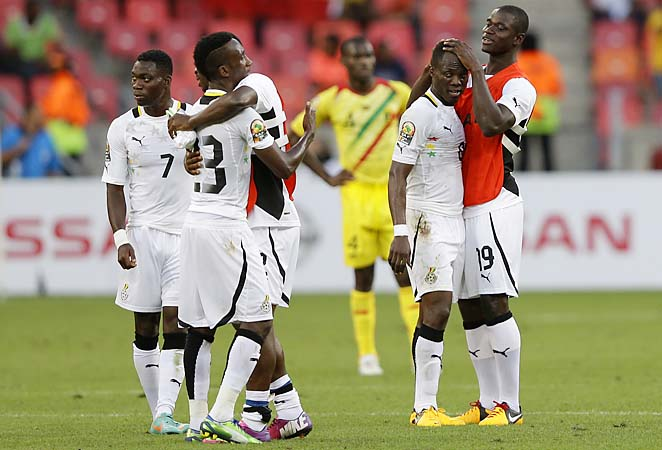 Ghana players hug after the final whistle in their African Cup of Nations Group B soccer match against Mali.