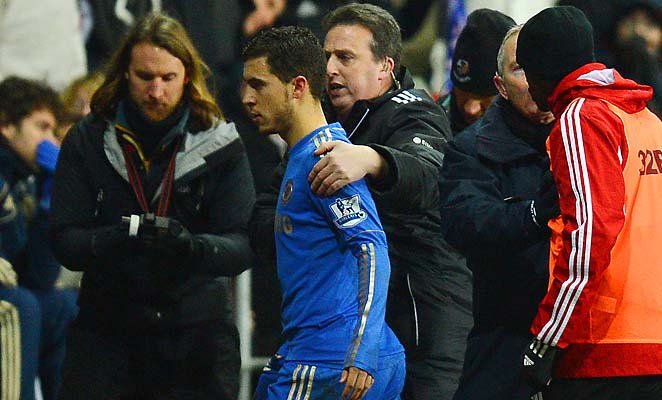 Eden Hazard walks off the field after being ejected for kicking a ball boy Wednesday.