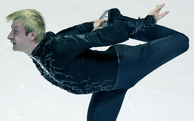 Evgeni Plushenko fell while trying to execute a triple axel and placed sixth before deciding to drop out of Saturday's free skate.