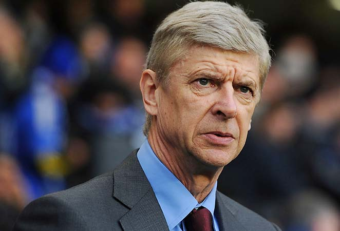 Arsene Wenger and Arsenal are in sixth place in the Premier League standings.