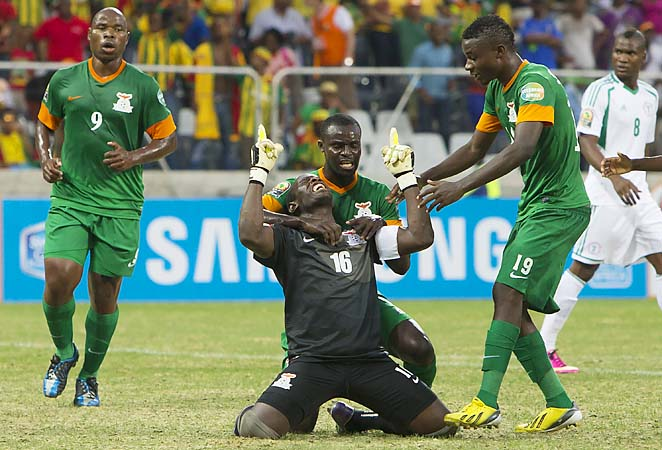 Goalkeeper Kennedy Mweene of Zambia celebrates with teammates after scoring a goal from the penalty spot.