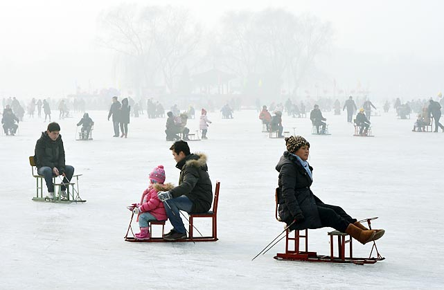 From the Currier & Ives collection, some winter holiday hoo-hah on Houhai Lake in Beijing, where temperatures hit minus-18 but hardly stop the hardy (and, frankly, insane) from skating, swimming and exercising their pooches.