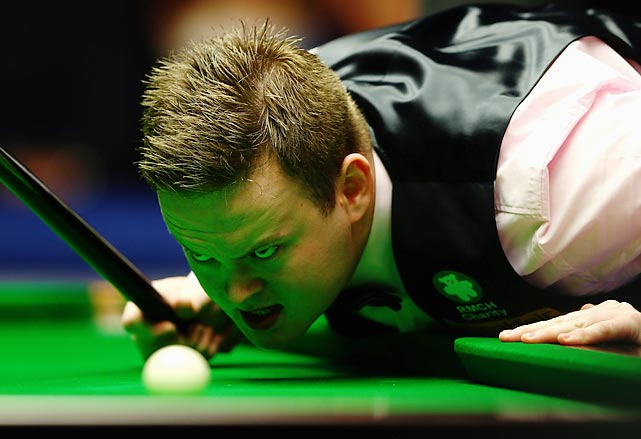 Looking somewhat possessed, Shaun Murphy lines up a shot in his semifinal match against Neil Robertson. Alas, Murphy had a devil of a time, coughing up a 68-point lead and suffering a loss that made his head spin.
