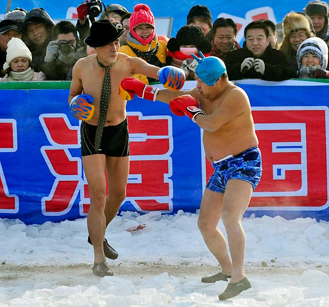 With just the press of an iron, swim trunks are easily converted into boxing trunks as these two pugs in Harbin, China are demonstrating.