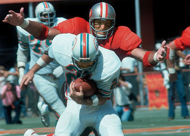 """Nicknamed """"The Intimidator,"""" the converted outside linebacker prided himself on not being blocked and keeping tight ends on the line of scrimmage. Tallying 104 solo tackles, four forced fumbles and 13 tackles for a loss in 1973, Wilcox even made use of his speed and long reach to collect 14 career interceptions."""