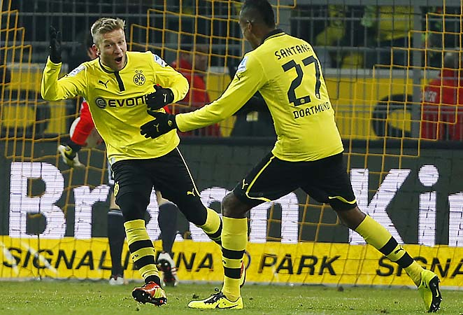 Dortmund's Jakub Blaszczykowski (left) celebrates scoring with teammate Felipe Santana.