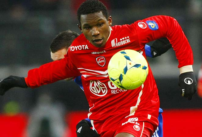 Valenciennes defender Nicolas Isimat-Mirin controls the ball during his Ligue 1 match against Lyon.