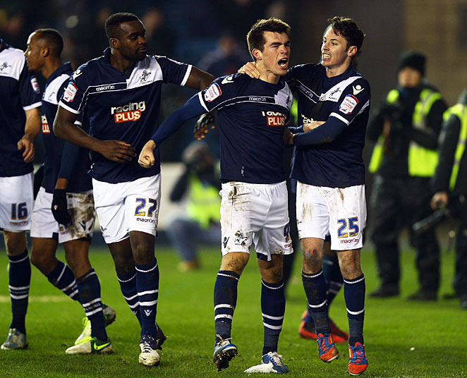 Millwall's John Marquis (center) celebrates his game-winning goal in the 89th minute.