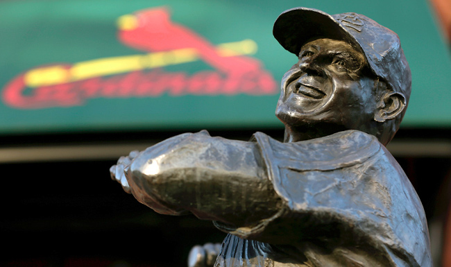 After the service, the hearse and vans filled with the Cardinals' delegation drove to Busch Stadium, where Stan Musial's family laid flowers at the base of one of his statues.