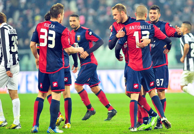 Genoa players celebrate after a 1-1 draw with Juventus.