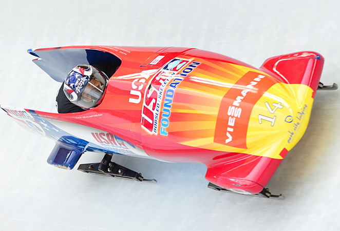 Lolo Jones and the U.S. combined bobsled sunk Germany by 0.24 seconds at the world championships.