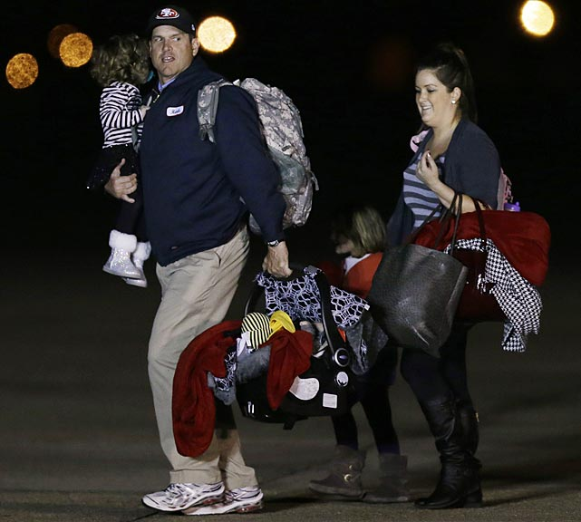 San Francisco 49ers head coach Jim Harbaugh and family arrive.