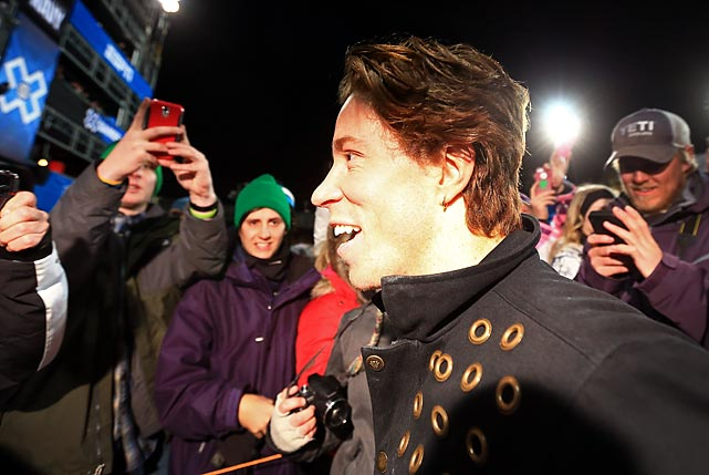 White greets fans after winning his gold medal. The snowboarder kept a casual attitude to the competition, hopping up on the SuperPipe wall to high-five fans during a practice run and stopping to pose for photos after his second run of the competition.