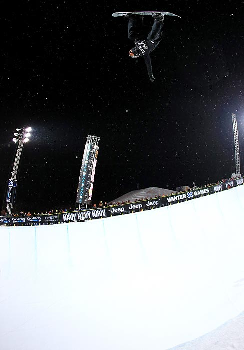 White does a soaring backside air in the SuperPipe competition. One day after his frustrating performance in the slopestyle competition, he was back to his gold medal ways on the SuperPipe.