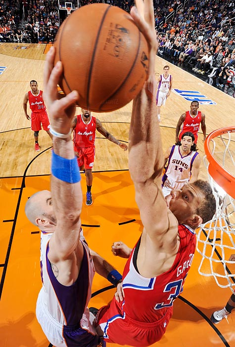 Los Angeles Clippers power forward Blake Griffin rejects Phoenix Suns center Marcin Gortat's dunk attempt. Playing without point guard Chris Paul, the Clippers struggled offensively, hitting just 39.8 percent of their shots in the 93-88 loss.