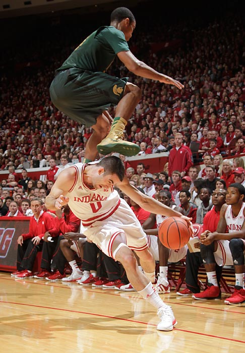 Indiana forward Will Sheehey takes the underneath route to the hoop, cutting beneath his leaping defender in the Hoosiers' Big Ten battle with Michigan State. Led by 21 points from Victor Oladipo, Indiana held off the Spartans 75-70.