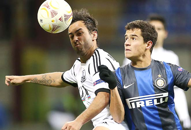 Coutinho (right) challenges for the ball with Neftci's Bruno Bertucci during a Europa Leaguee match.