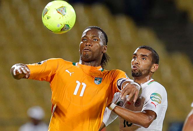 Didier Drogba (left) fights for the ball with Algeria's Kaled Lemmouchia during their African Cup of Nations group match.