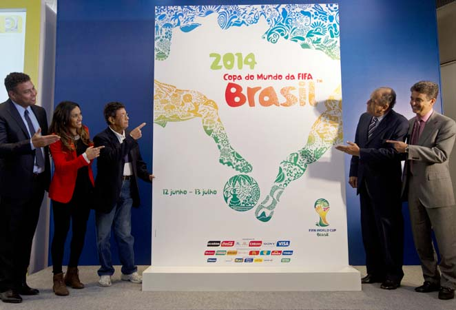 Ronaldo (left) and Marta (second form left) help present the 2014 World Cup poster.