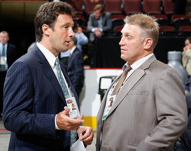 General manager Doug Thomas, seen here speaking to Brett Hull, will continue his day-to-day operations through the Sharks' ownership change.