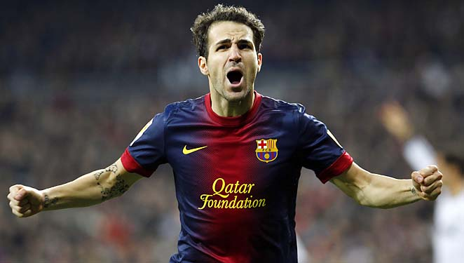 Cesc Fabregas celebrates after scoring in the 50th minute for Barcelona.