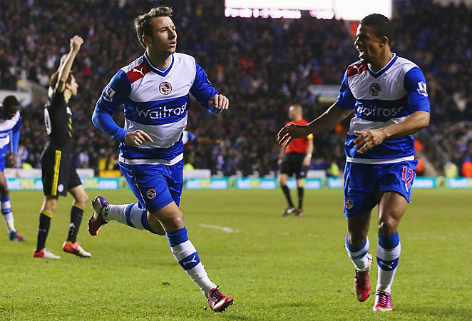 Adam Le Fondre (left) scored in the 87th and 90th minutes to lift Reading to a draw with Chelsea.