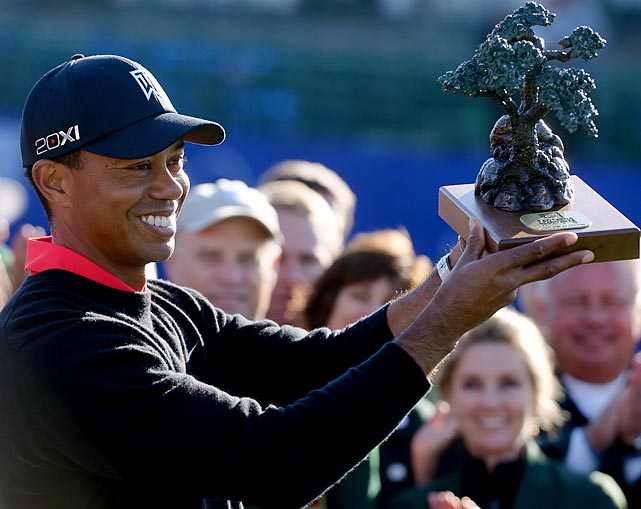 The winner of the Farmer's Insurance Open hoists the coveted Broccoli Trophy (yes, it is completely edible) at Torrey Pines Golf Course in La Jolla, CA.